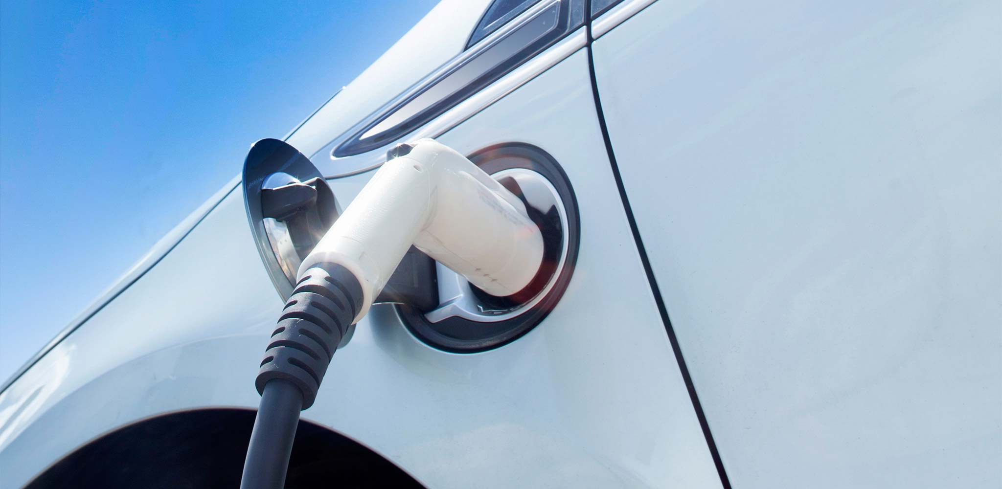 An e-car connected to the power supply symbolizes electromobility, an important sales market for MAPAL.